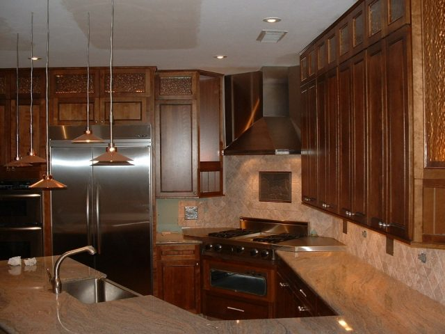 Common Kitchen Design Mistakes: cooking area too close to a tall cabinet