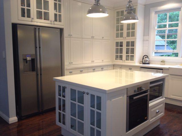 white kitchen with glass doors IKEA cabinets Australia