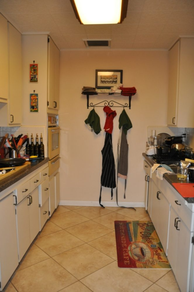 This galley kitchen needed more counter space to make it efficient.