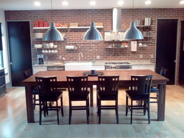 Our customer chose industrial light fixtures that tie the kitchen look nicely.