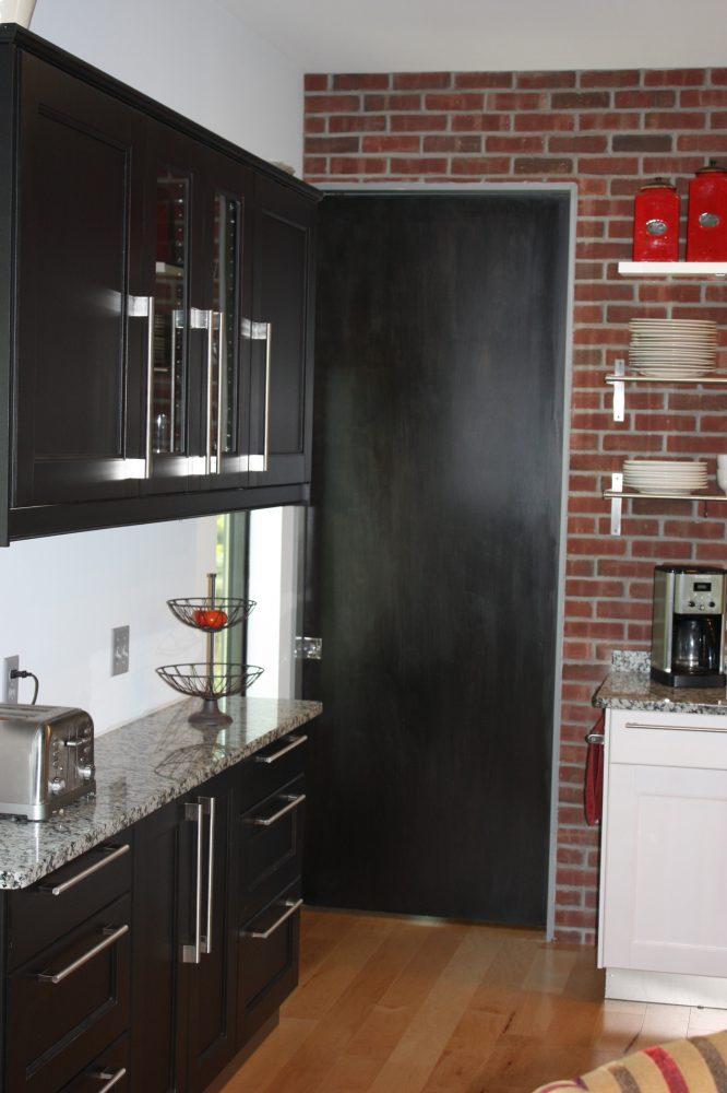TYDA handles look modern and chic against the dark, custom-stained ADEL doors.