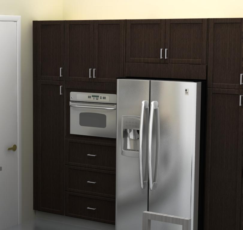 The gap between the refrigerator and the cabinets is filled with a filler panel.