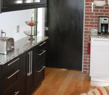 """For this tricky walkway, we used 12""""-deep drawer bases with RAMSJO fronts in a black-brown finish."""