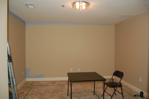 The homeowners have marked the spaced planned for cabinets with painter's tape on the floor.