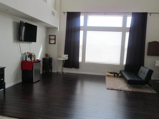 The room has nice, tall ceilng and lots of natural light due to a huge window.