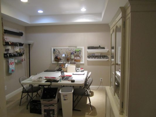 This craft room is spacious but it's in serious need of more storage.