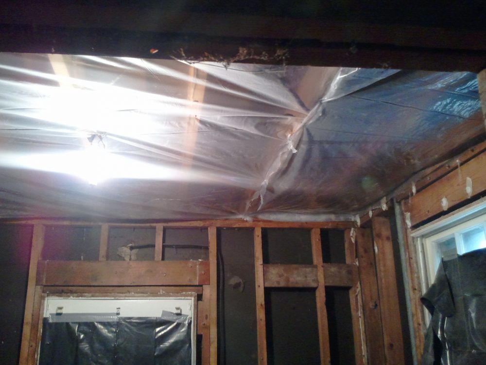 Old soffit material was removed from the ceiling to make room for higher wall cabinets.