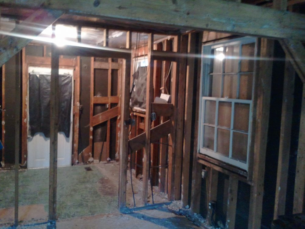 A wall in the middle will be removed to open up the kitchen and take the space of an unused dining room.