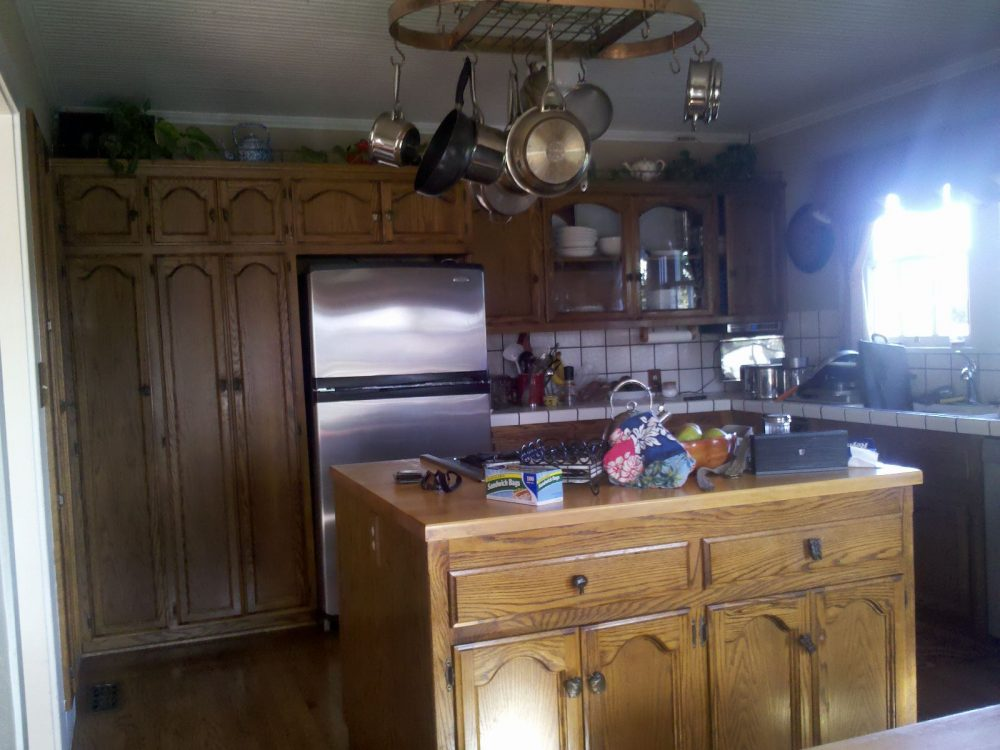 The tall cabinets didn't reach the ceiling and the space above started to get cluttered and dusty.