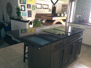 The island is small and functional but the colors are too dark for such a small kitchen.