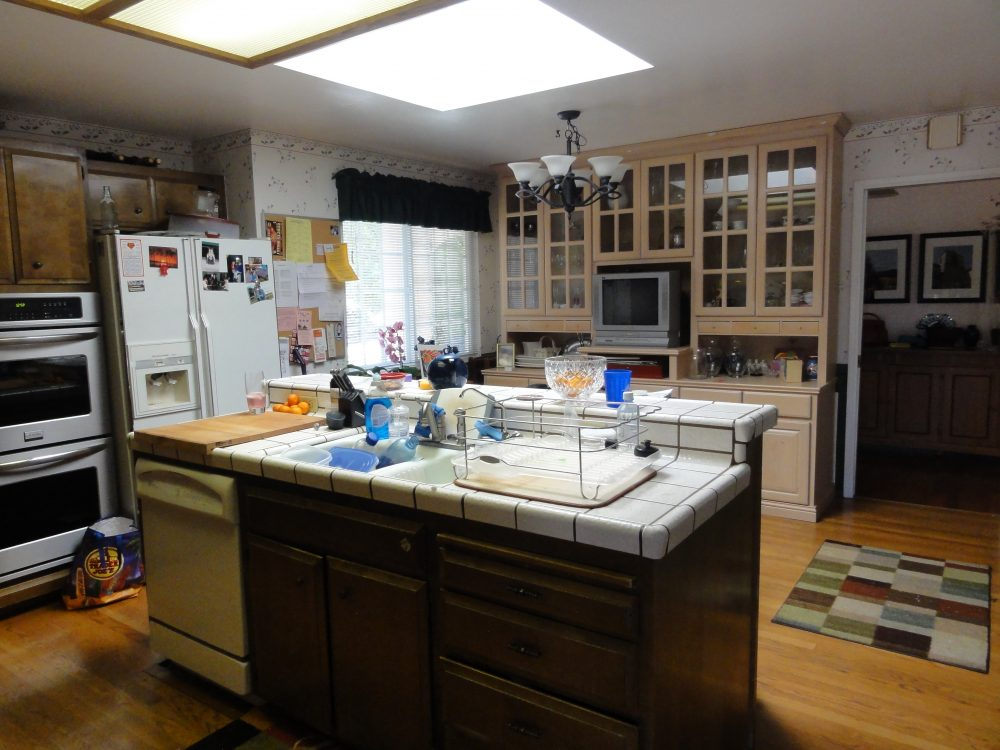 The kitchen island interrupts the workflow and the television needs to be taken out of the kitchen.