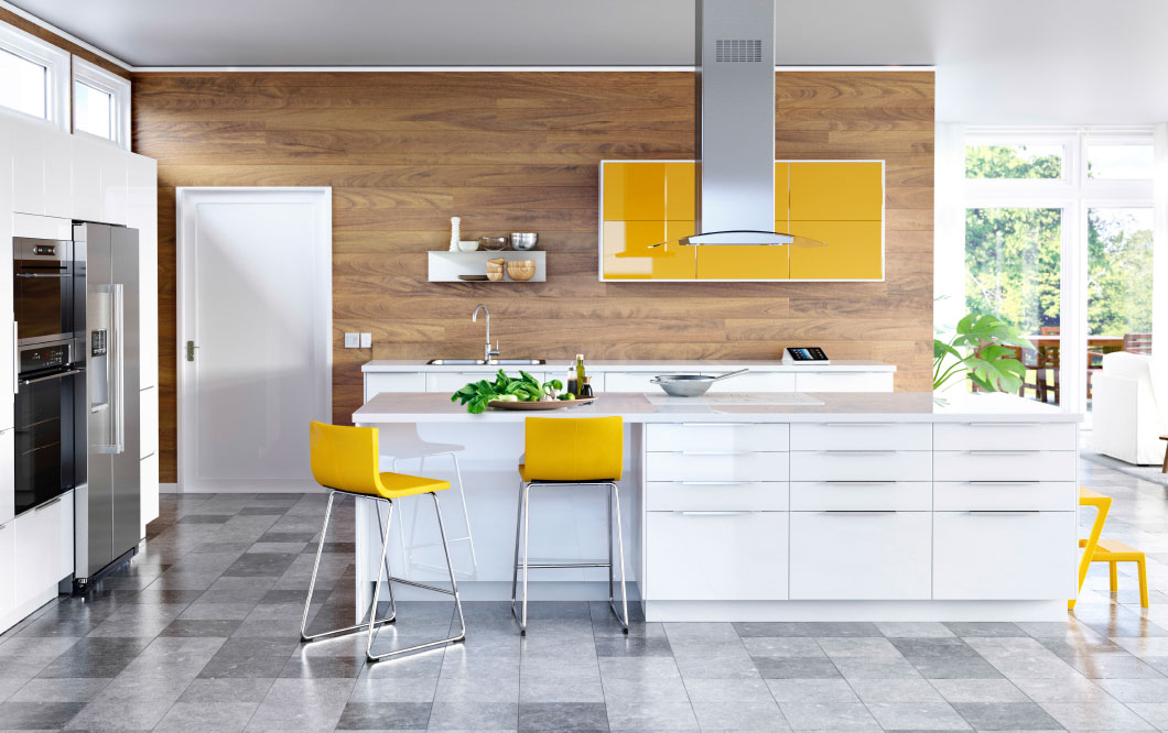 Why the little white ikea kitchen is so popular for Modern yellow kitchen cabinets