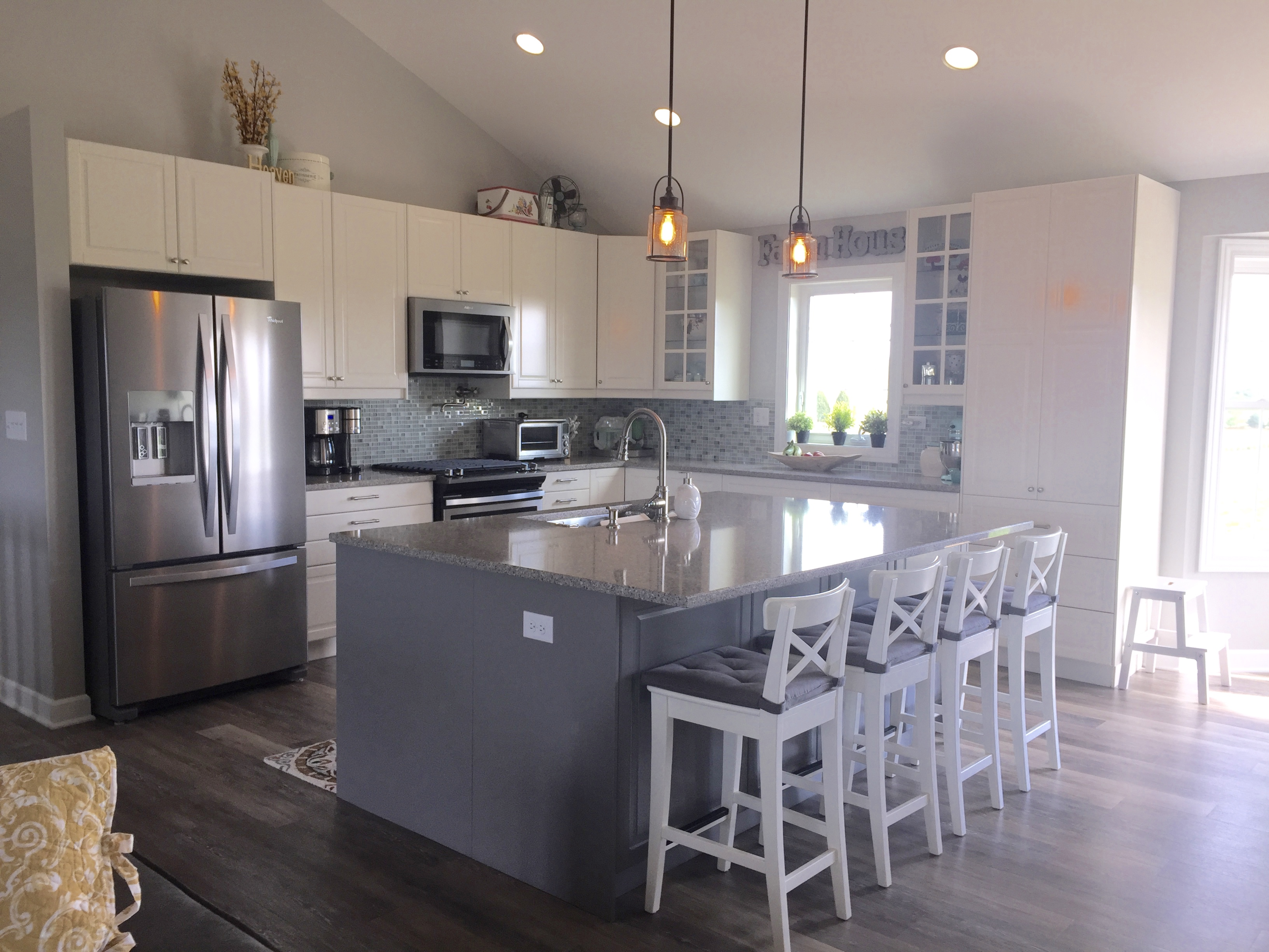 A modern farmhouse kitchen for a self described ikea freak for Farmhouse style kitchen lighting